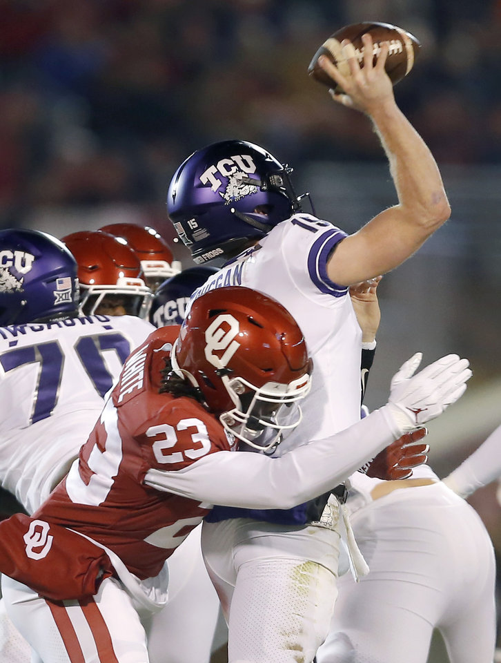 Photo - Oklahoma's DaShaun White (23) bings down TCU's Max Duggan (15) during an NCAA football game between the University of Oklahoma Sooners (OU) and the TCU Horned Frogs at Gaylord Family-Oklahoma Memorial Stadium in Norman, Okla., Saturday, Nov. 23, 2019. [Bryan Terry/The Oklahoman]