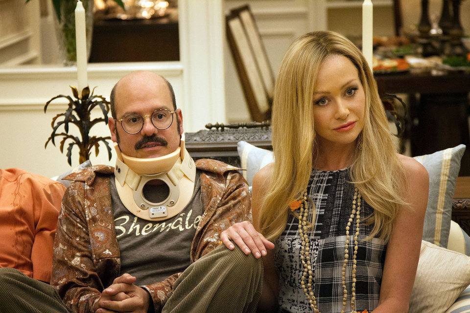 Photo - This undated publicity photo released by Netflix shows David Cross, left, and Portia de Rossi in a scene from