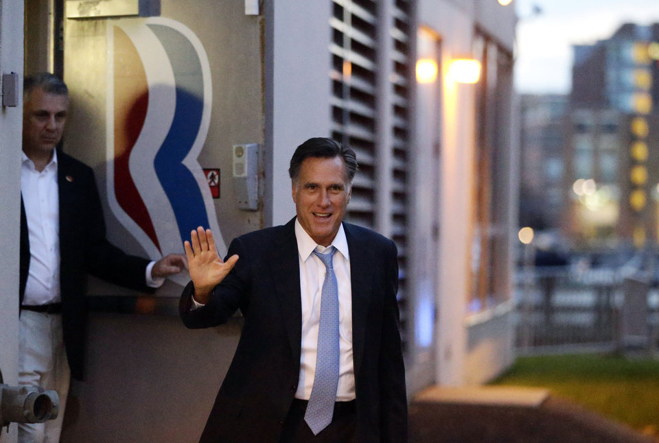 Republican presidential candidate and former Massachusetts Gov. Mitt Romney leaves his campaign headquarters in Boston, Sunday, Sept. 30, 2012. (AP Photo/Charles Dharapak)
