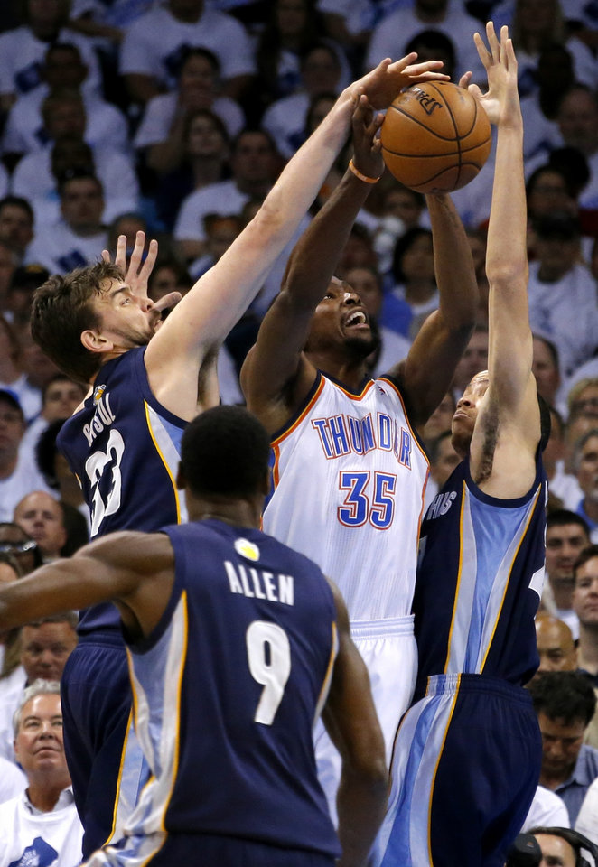 Photo - Oklahoma City's Kevin Durant has his shot blocked by Memphis' Marc Gasol as Tayshaun Prince helps defend during Game 5 in the second round of the NBA playoffs between the Oklahoma City Thunder and the Memphis Grizzlies at Chesapeake Energy Arena In Oklahoma City, Wednesday, May 15, 2013. Photo by Bryan Terry, The Oklahoman