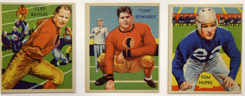 Photo - Cliff Battles, Turk Edwards, and Tom Hupke are among a set of 1935 National Chicle Gum Company vintage football trading cards, shown Wednesday, Jan. 8, 2014, at the Metropolitan Museum of Art. Edwards's nine-year NFL career with the Redskins ended after an injury during a coin toss. 150 football trading cards, including a series from 1894, are part of approximately 600 cards from the museum's vast collection of sport trade cards donated to the Met by the late hobby pioneer Jefferson Burdick. The exhibit runs Jan. 24 through Feb. 10. (AP Photo/Kathy Willens)