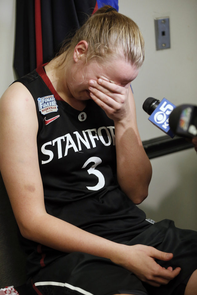 Photo - Stanford forward Mikaela Ruef sits in the locker room after the second half of the semifinal game against Connecticut in the Final Four of the NCAA women's college basketball tournament, Sunday, April 6, 2014, in Nashville, Tenn. Connecticut won 75-56. (AP Photo/John Bazemore)