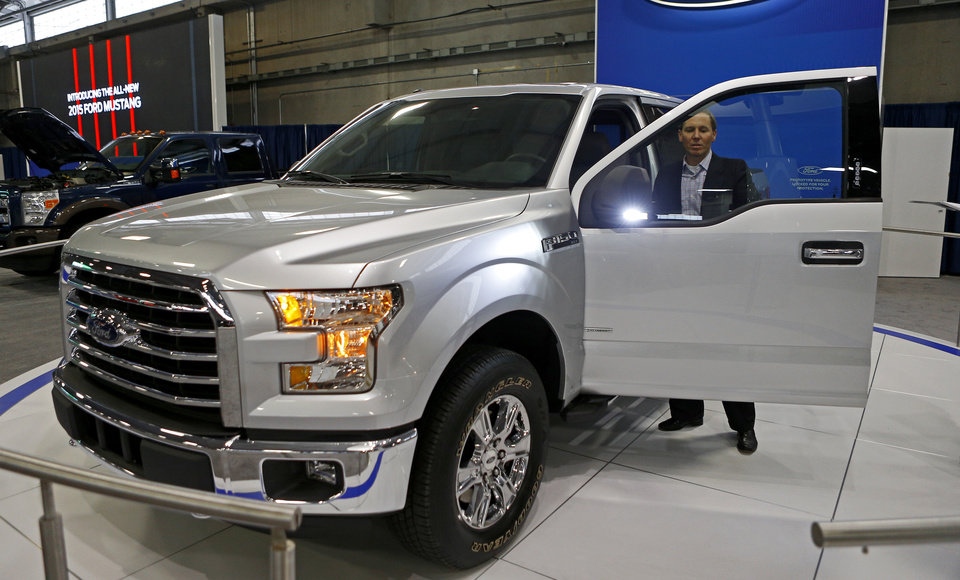 Photo - Ford's Brandt Coultas talks Wednesday about the new features on the 2015 Ford F-150 XLT, which will be on display at the upcoming Oklahoma City International Auto Show at State Fair Park.  Photos by Bryan Terry, The Oklahoman  BRYAN TERRY - THE OKLAHOMAN