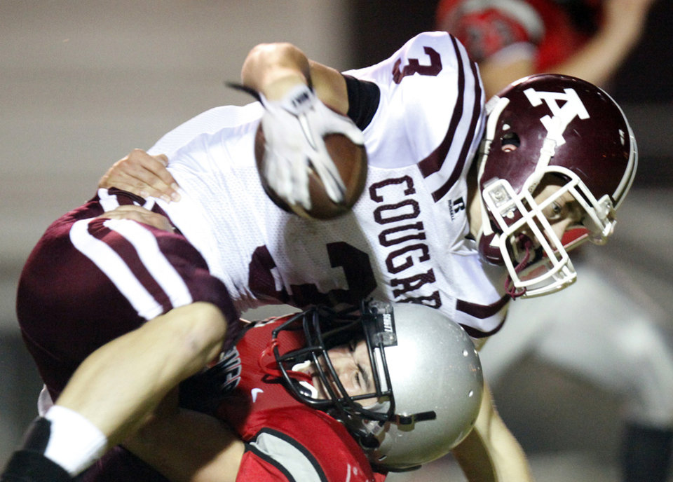 Photo - Ada's Easton Pingleton (3) is tackled by  a U.S. Grant defender during a high school football game between Ada and U.S. Grant at C.B. Speegle Stadium in Oklahoma City, Friday, Sept. 16, 2011. Photo by Nate Billings, The Oklahoman