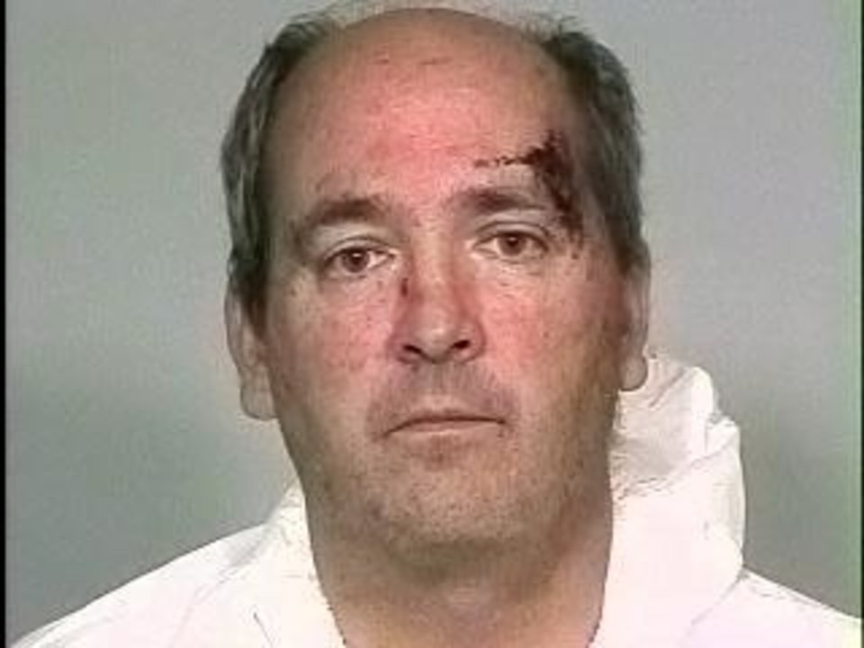 Photo - STEPHEN PAUL WOLF / MURDER / HOMICIDE / SON / CHILD / ARREST / STEPHEN WOLF: Stephen P. Wolf,  51, a physician, was arrested Monday, Nov. 16, 2009, in connection with the death of his 9-year-old son Tommy. Wood was arrested after the incident at his home, 1715 Elmhurst Ave., in Nichols Hills. Provided by Oklahoma County jail. ORG XMIT: KOD