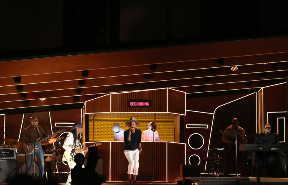 Photo - Nile Rodgers, from second left, Thomas Bangalter, Pharrell Williams, Guy-Manuel de Homem-Christo, and Stevie Wonder perform at the 56th annual Grammy Awards at Staples Center on Sunday, Jan. 26, 2014, in Los Angeles. (Photo by Matt Sayles/Invision/AP)