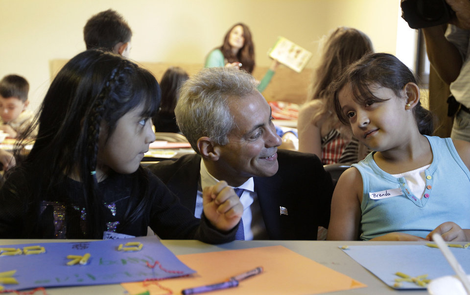 Photo -   Chicago Mayor Rahm Emanuel visits with students Jacquelina Mena, left, and Brenda Pena at Maranatha Church in Chicago, Monday, Sept. 10, 2012, where students were being provided structured activities in their community and safe environment during a teachers strike. Thousands of Chicago Public School teachers walked off the job Monday in the nation's third-largest school district for the first time in 25 years after union leaders announced they were far from resolving a contract dispute with school district officials. (AP Photo/M. Spencer Green)