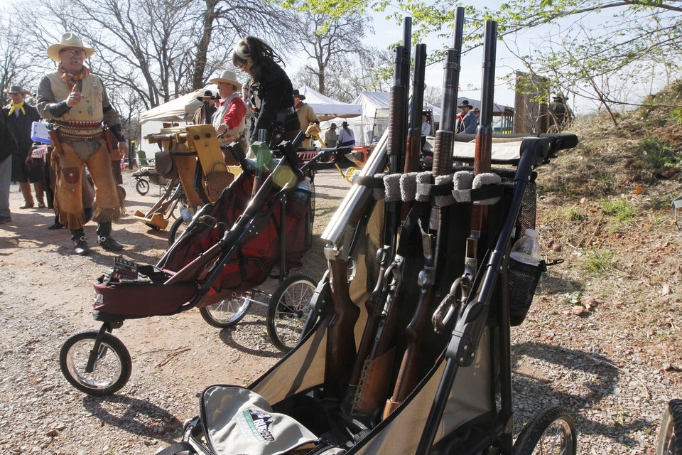 Photo - Carts are full of cowboy style guns during the Land Run, the biggest cowboy action shoot of the year Friday at the Oklahoma City Gun Club. Photo By Paul Hellstern, The Oklahoman
