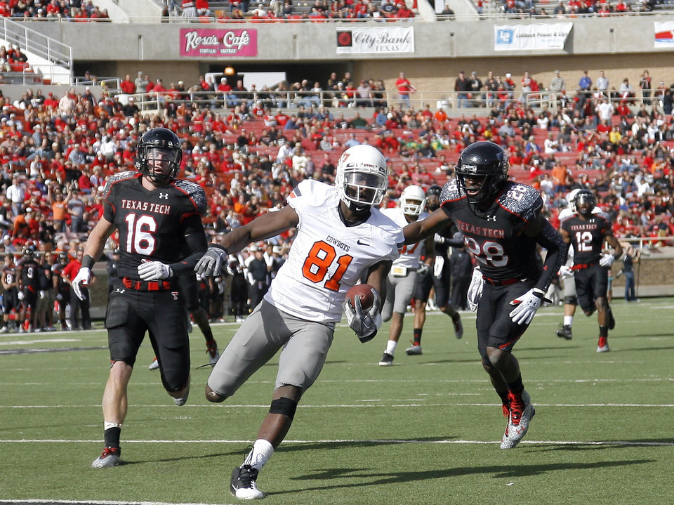 Photo - Oklahoma State's Justin Blackmon (81) scores a touchdown as he is chased by Texas Tech's Cody Davis (16) and Happiness Osunde (28) during a college football game between Texas Tech University (TTU) and Oklahoma State University (OSU) at Jones AT&T Stadium in Lubbock, Texas, Saturday, Nov. 12, 2011.  Photo by Sarah Phipps, The Oklahoman  ORG XMIT: KOD