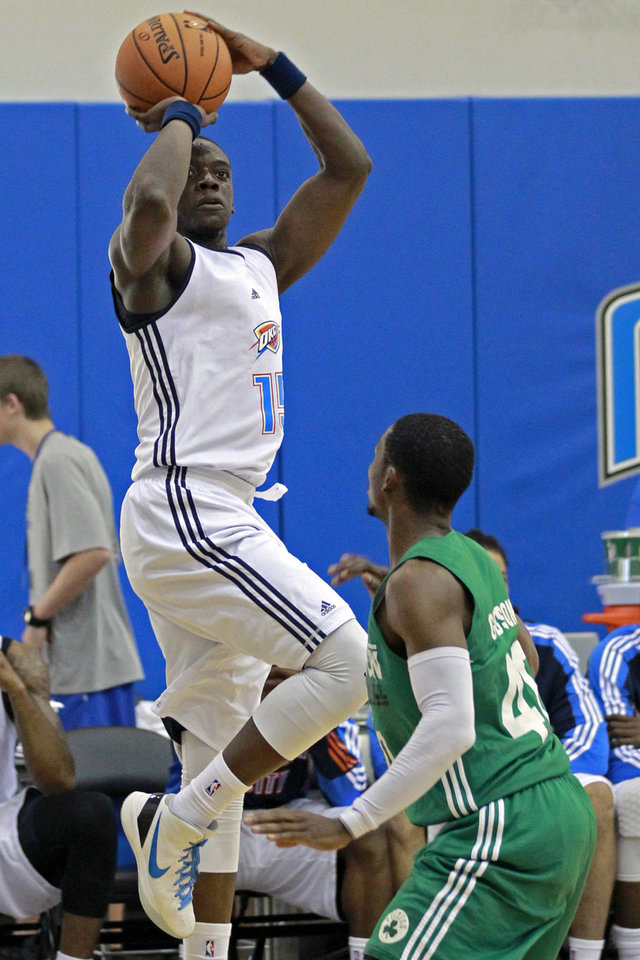 Oklahoma City Thunder's Reggie Jackson, left, shoots over Boston Celtic's Jonathan Gibson during an NBA summer league basketball game, Monday, July 9, 2012, in Orlando, Fla. (AP Photo/John Raoux) ORG XMIT: DOA107