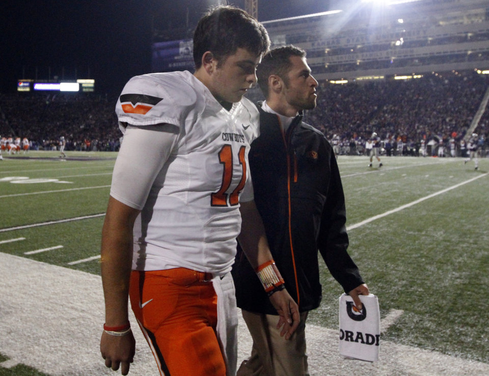 Oklahoma State\'s Wes Lunt (11) walks off the field during the college football game between Kansas State University (KSU) and Oklahoma State (OSU) at Bill Snyder Family Football Stadium in Manhattan, Kan., Saturday, Nov. 3, 2012. Photo by Sarah Phipps, The Oklahoman