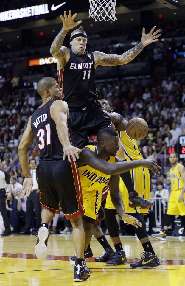 Photo - Indiana Pacers' Lance Stephenson (1) is fouled by Miami Heat's Chris Andersen (11) during the first half of an NBA basketball game in Miami, Sunday, March 10, 2013. (AP Photo/Alan Diaz)