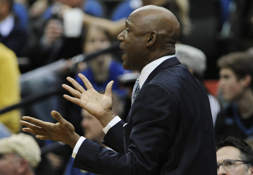 Photo - Minnesota Timberwolves acting head coach Terry Porter questions a call in the first half of an NBA basketball game against the Brooklyn Nets, Wednesday, Jan. 23, 2013, in Minneapolis. The Nets won 91-83. (AP Photo/Jim Mone)