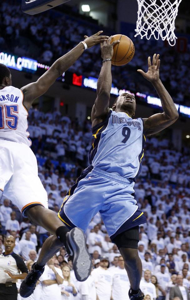 Photo - Oklahoma City's Reggie Jackson (15) blocks the shot of Memphis' Tony Allen (9) during Game 5 in the first round of the NBA playoffs between the Oklahoma City Thunder and the Memphis Grizzlies at Chesapeake Energy Arena in Oklahoma City, Tuesday, April 29, 2014. Photo by Sarah Phipps, The Oklahoman