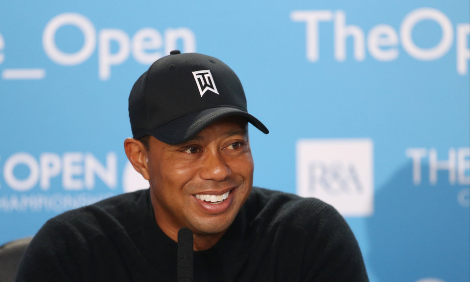 Photo - Tiger Woods of the US smiles during a press conference ahead of the British Open Golf championship at the Royal Liverpool golf club, Hoylake, England, Tuesday July 15, 2014. The British Open starts on Thursday July 17. (AP Photo/Peter Morrison)