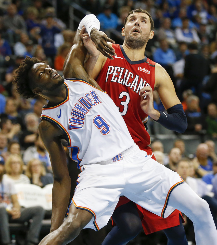 Photo - Oklahoma City's Jerami Grant (9) and New Orleans' Nikola Mirotic (3) fight for position during a free throw attempt by New Orleans in the fourth quarter of an NBA basketball game between the Oklahoma City Thunder and the New Orleans Pelicans at Chesapeake Energy Arena in Oklahoma City, Monday, Nov. 5, 2018. Oklahoma City won 122-116. Photo by Nate Billings, The Oklahoman