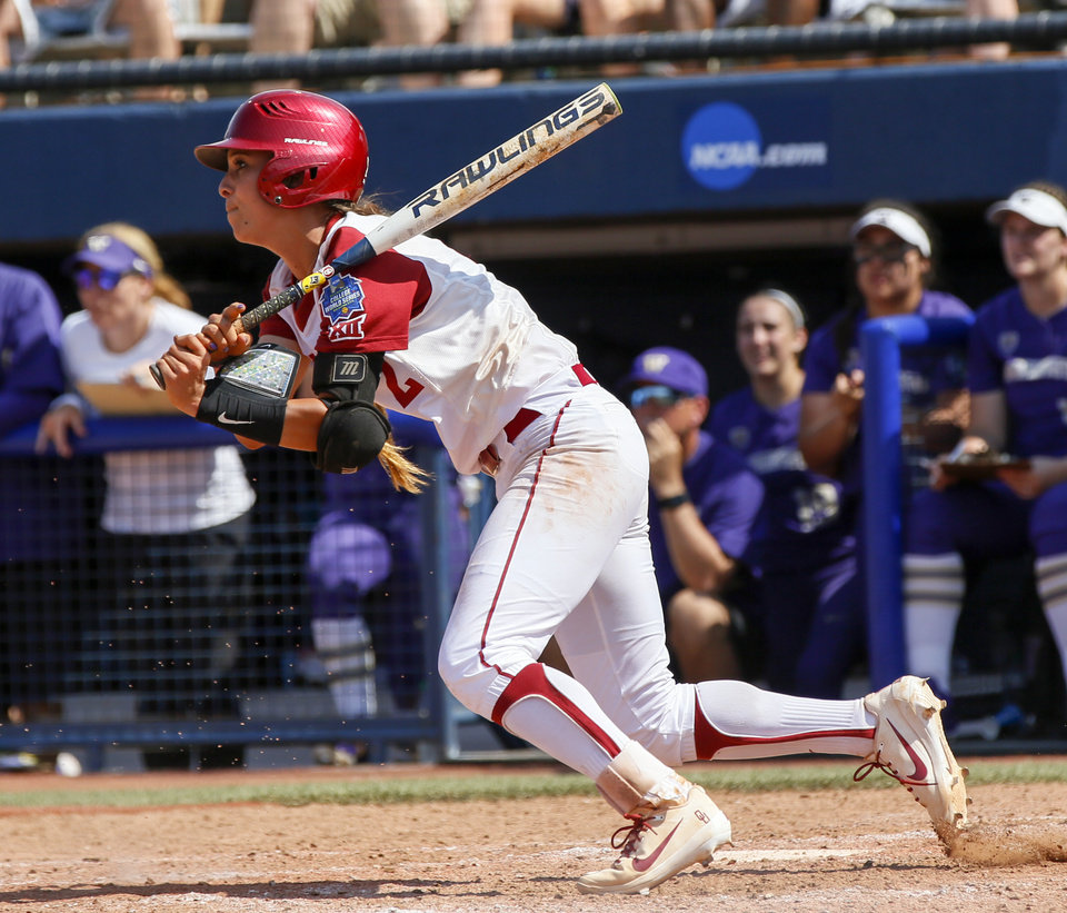 Photo - Oklahoma's Sydney Romero (2) singles in the bottom of the sixth inning during the second game of the Women's College World Series between the Oklahoma Sooners (OU) and Washington Huskies at USA Softball Hall of Fame Stadium in Oklahoma City, Thursday, May 31, 2018. Washington won 2-0. Photo by Nate Billings, The Oklahoman