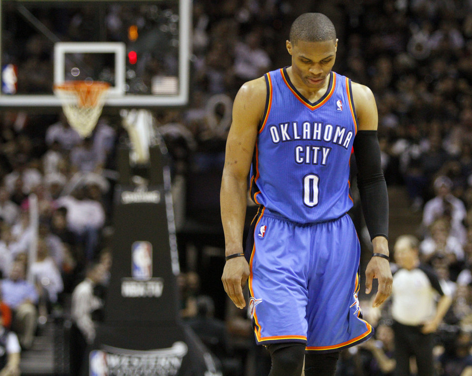 Photo - Oklahoma City's Russell Westbrook (0) walks towards the bench during Game 2 of the Western Conference Finals between the Oklahoma City Thunder and the San Antonio Spurs in the NBA playoffs at the AT&T Center in San Antonio, Texas, Tuesday, May 29, 2012. Oklahoma City lost 120-111. Photo by Bryan Terry, The Oklahoman