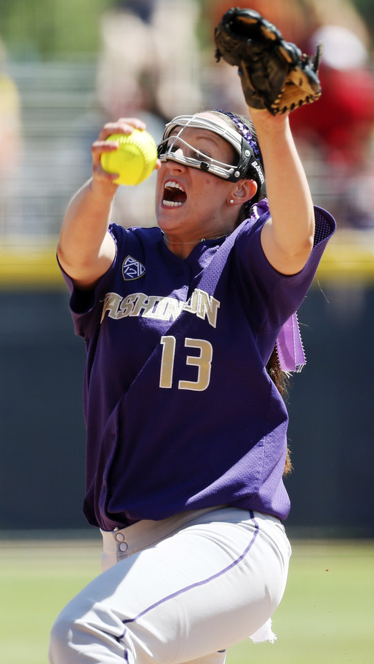 Photo - Kaitlin Inglesby (13) pitches for Washington during an NCAA softball game in the Women's College World Series between Washington and Tennessee at ASA Hall of Fame Stadium in Oklahoma City, Saturday, June 1, 2013. Tennessee won 1-0. Photo by Nate Billings, The Oklahoman
