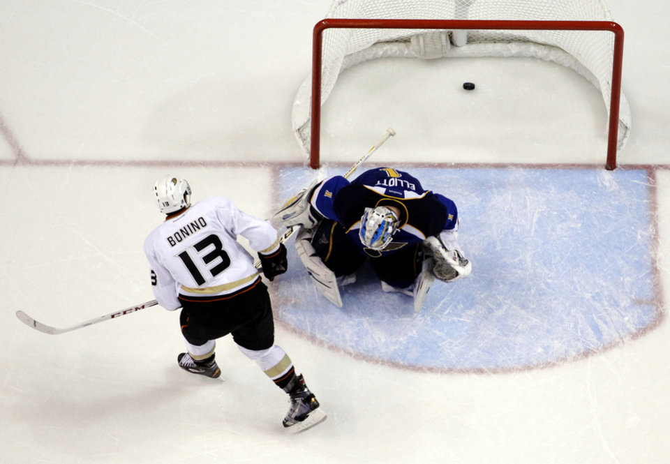 Anaheim Ducks' Nick Bonino (13) watches as his winning goal slips past St. Louis Blues goalie Brian Elliott in the shootout of an NHL hockey game, Saturday, Feb. 9, 2013, in St. Louis. The Ducks won 6-5. (AP Photo/Jeff Roberson)