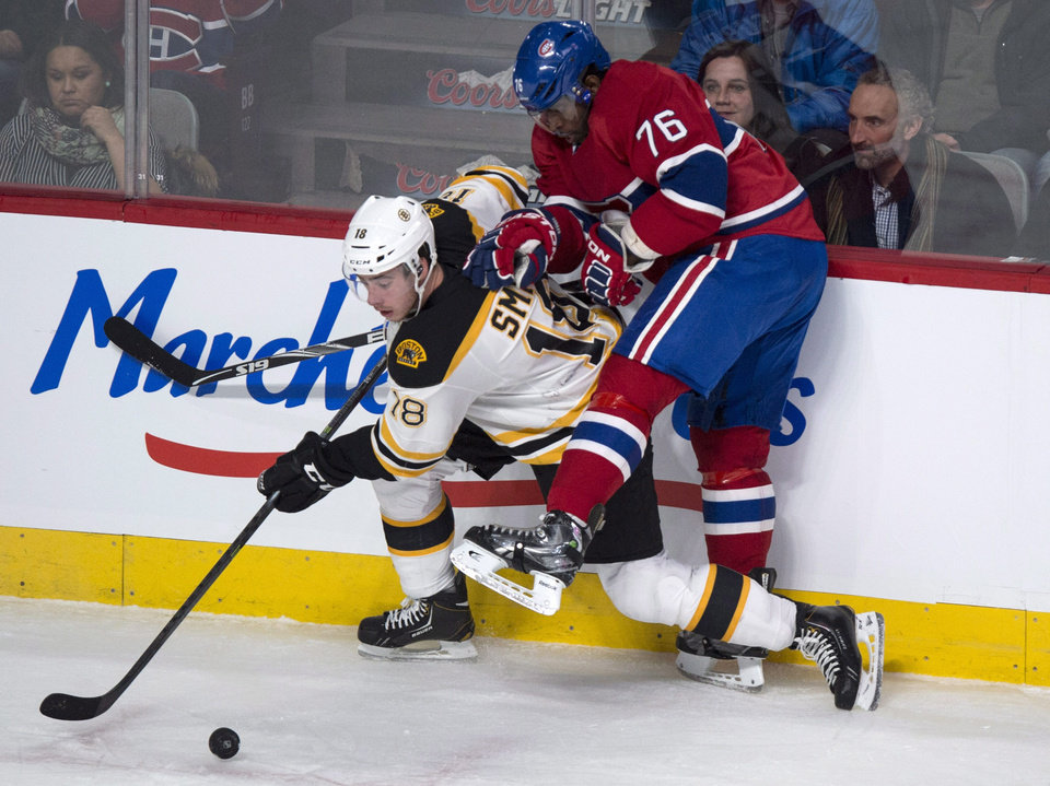 Photo - Montreal Canadiens' P.K. Subban tries to stop Boston Bruins' Reilly Smith during first period NHL hockey action Wednesday, March 12, 2014 in Montreal. (AP Photo/The Canadian Press, Paul Chiasson)