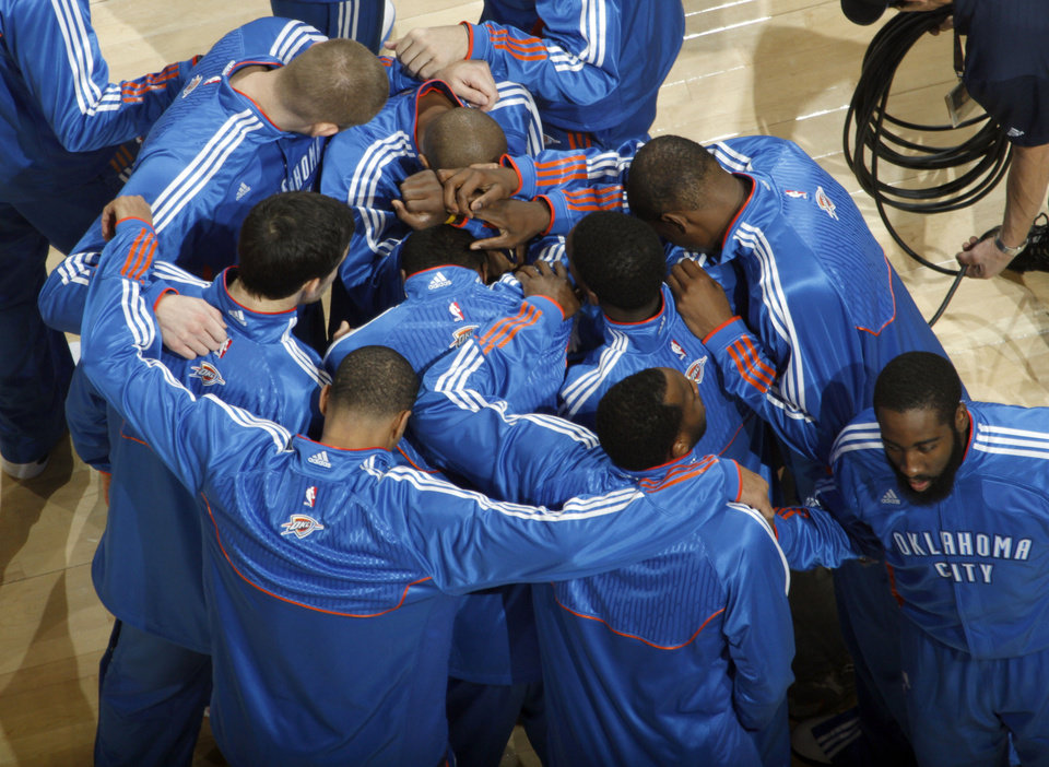 Photo - The Thunder huddle during the NBA basketball game between the Oklahoma City Thunder and the Phoenix Suns, Sunday, Dec. 19, 2010, at the Oklahoma City Arena. Photo by Sarah Phipps, The Oklahoman