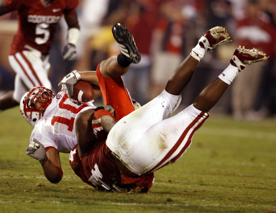 Jeremy Beal (44) takes down Roy Helu Jr. during the second half of the college football game between the University of Oklahoma Sooners (OU) and the University of Nebraska Huskers (NU) at the Gaylord Family Memorial Stadium, on Saturday, Nov. 1, 2008, in Norman, Okla. 