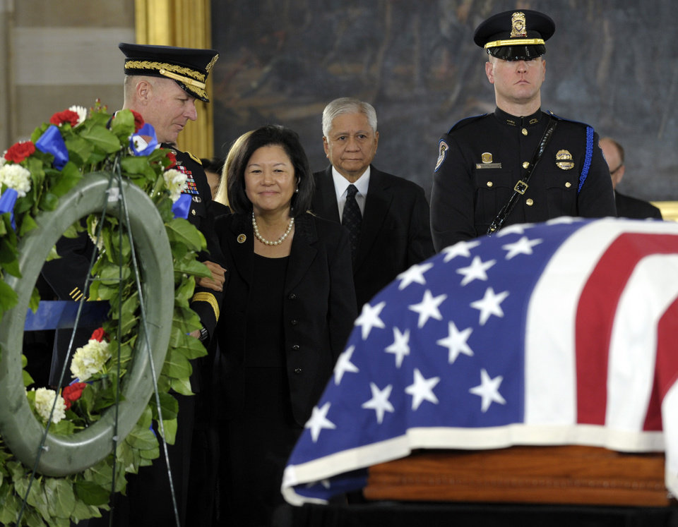 Photo - Irene Hirano Inouye, widow of Sen. Daniel Inouye, D-Hawaii, who was the second-longest-serving senator in history, looks at the casket of her husband as he lies in state in the Capitol Rotunda in Washington, Thursday, Dec. 20, 2012. Sen. Inouye was a Medal of Honor recipient who represented his state in the U.S. House and then the Senate, where he served for five decades. He died Monday evening at age 88 of respiratory complications. (AP Photo/Susan Walsh)
