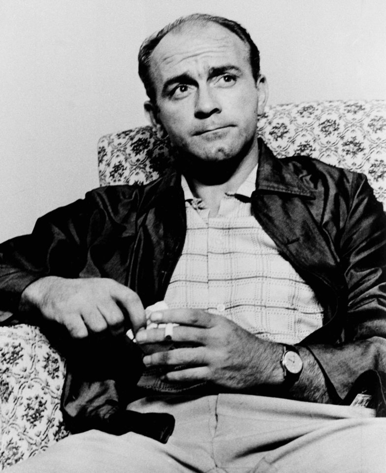 FILE - In this Aug. 26, 1963 file photo, Alfredo di Stefano smokes a cigarette as he talks to newsmen at the Spanish Embassy immediately after his release by communist kidnappers, in Caracas, Venezuela. Stefano, in Caracas with his team of Real Madrid, was held prisoner for 56 hours in a Caracas apartment by members of the outlawed pro-communist Armed Forces for National Liberation. FALN, which seeks to overthrow President Romulo Betancourt, utilized the kidnapping as a publicity stunt and to embarrass the Venezuelan government. Di Stefano, whose goals placed him alongside the all-time great players and propelled Real Madrid to five straight European Champions Cups, has died on Monday, July 7, 2014. He was 88. (AP Photo/File)
