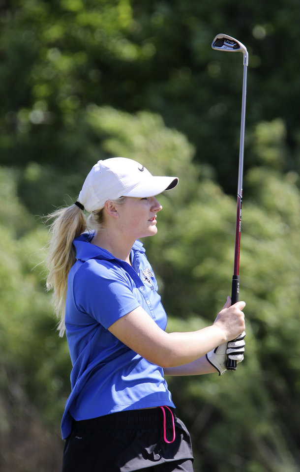 Photo - Harrah senior Sydney Hessman watches a tee shot at Lake Hefner golf course in Oklahoma City,  Wednesday May 07, 2014. Photo By Steve Gooch, The Oklahoman