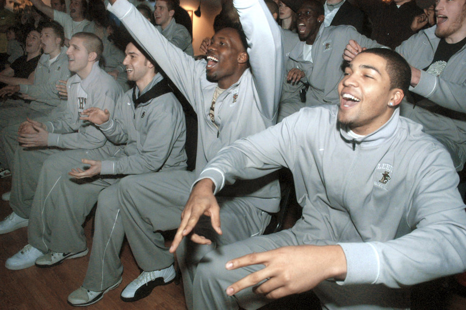 From left, Lehigh University basketball players Dave Buchberger, Matt Shamis, Zahir Carrington and John Adams celebrate with teammates as they hear their school named as the opponent for No. 1 seed Kansas on Sunday in Bethlehem, Pa. AP Photo