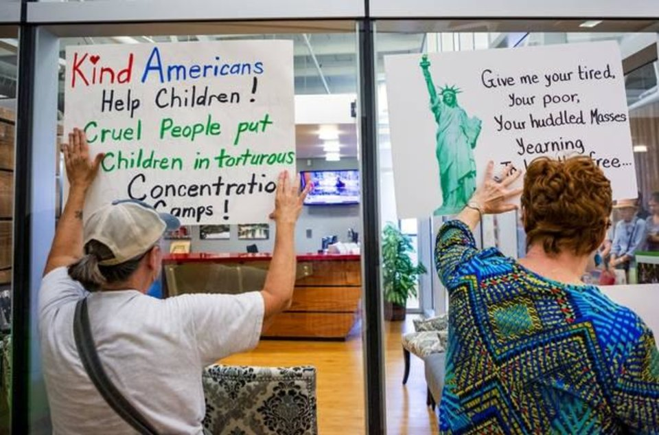Photo -  Protesters gather outside Senator James Lankford's office to show their opposition to separating children from their parents at the border on Wednesday, July 3, 2019.    [Chris Landsberger/The Oklahoman]