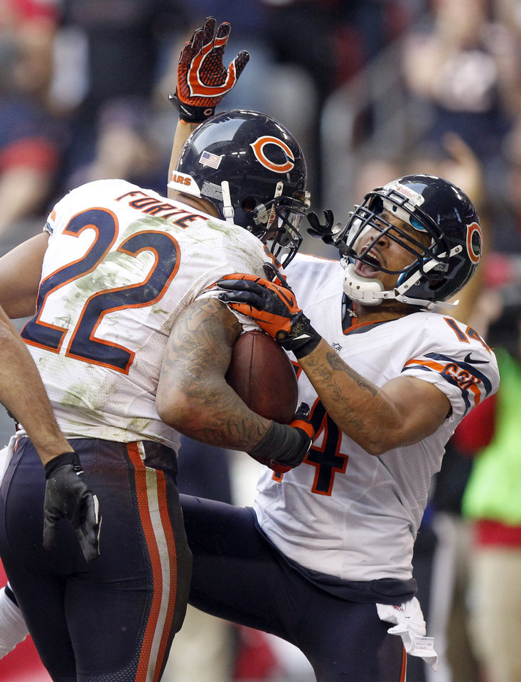 Photo - Chicago Bears running back Matt Forte (22) celebrates his touchdown with teammate Eric Weems (14) against the Arizona Cardinals during the first half of an NFL football game, Sunday, Dec. 23, 2012, in Glendale, Ariz. (AP Photo/Paul Connors)