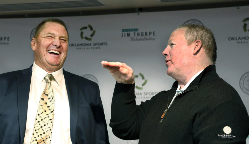 Photo - The Oklahoma Sports Hall of Fame Induction Class of 2019 was introduced Tuesday, Feb. 19, 2019, at the organization's leadership luncheon at the Jeaneen and Bob Naifeh Family & Bud Wilkinson Event Center.  Retired major league baseball players Mike Moore, left,  and Mickey Tettleton laugh while sharing stories from their baseball careers after the event.  Other inductees present, but not pictured, are Bob Stoops, Will Shields, Patty Gasso and Kendall Cross. Inductee Lou Henson was unable to be present at the luncheon. Photo by Jim Beckel, The Oklahoman.