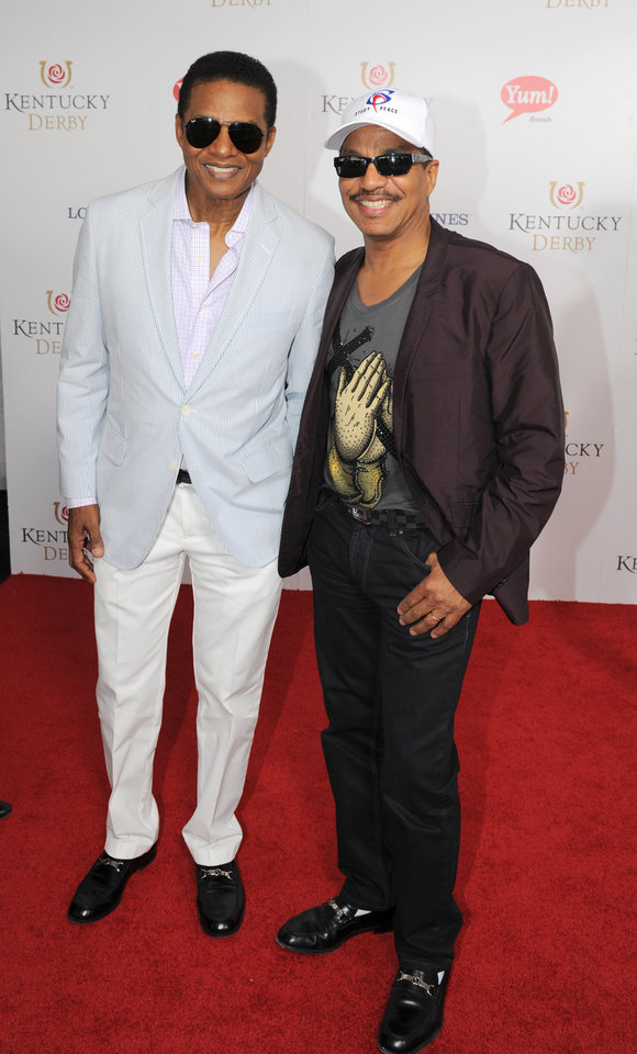 Photo - Marlon and Jackie Jackson are photographed at the 140th Kentucky Derby Saturday, May 3, 2014 in Louisville Ky. (Photo by Joe Imel/Invision/AP)