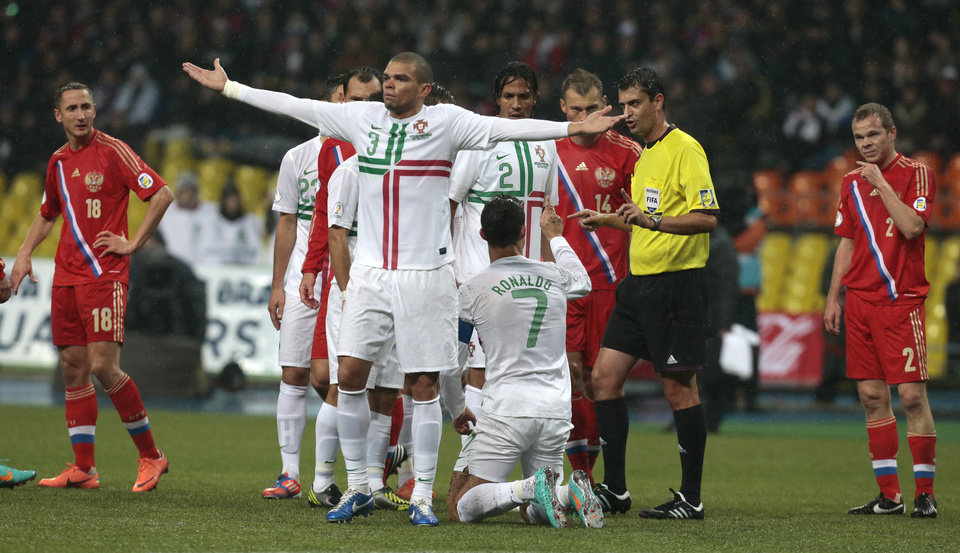 Photo -   Portugal's Pepe, center, gestures after Russia's team attacks in their World Cup 2014 Group F qualification match at Luzhniki stadium in Moscow, Russia, on Friday, Oct. 12, 2012. (AP Photo/Mikhail Metzel)