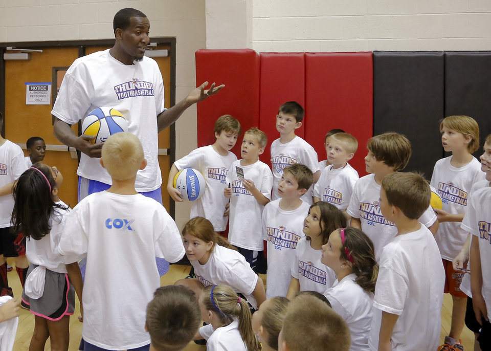 CHILD / CHILDREN / KIDS: Oklahoma City Thunder's Kendrick Perkins talks with the participants in the Oklahoma City Thunder basketball camp at Mid-America Christian University on Wednesday, June 19, 2013 in Oklahoma City, Okla.   Photo by Chris Landsberger, The Oklahoman
