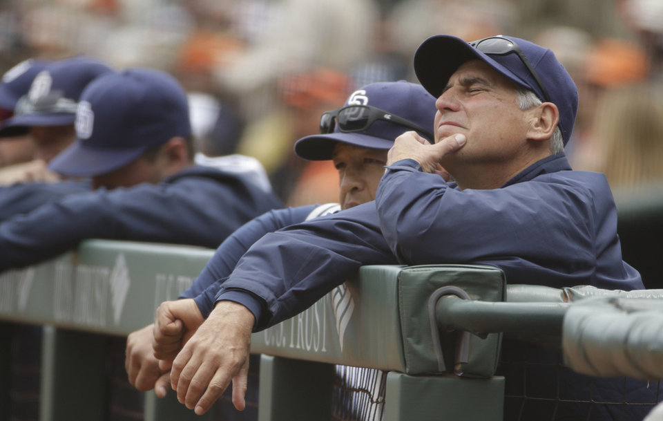 Photo - San Diego Padres manager Bud Black, right, and bench coach Dave Roberts, second from right, rest on the dugout railing in the first inning of their baseball game against the San Francisco Giants Wednesday, June 25, 2014, in San Francisco. San Francisco won the game 4-0. The Giants' Tim Lincecum threw his second career no-hitter. (AP Photo/Eric Risberg)
