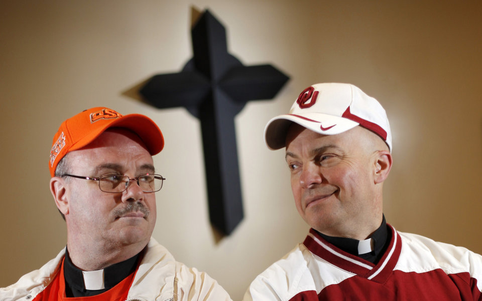 Photo - Father Dan Letourneau wears OSU gear and Father John Metzinger wears his OU gear at St. Elizabeth Ann Seton Catholic School in Edmond Friday, Nov. 19, 2010. Photo by Doug Hoke, The Oklahoman.