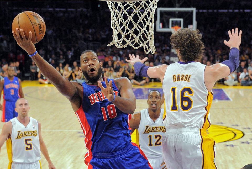 Detroit Pistons center Greg Monroe (10) puts up a shot as Los Angeles Lakers forward Pau Gasol, of Spain, defends during the first half of their NBA basketball game, Sunday, Nov. 4, 2012, in Los Angeles. (AP Photo/Mark J. Terrill)