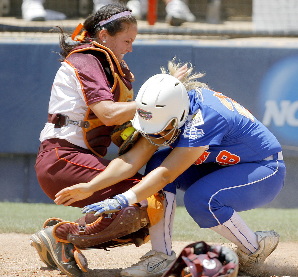 Kelsey Hoffman of Virginia Tech tags out Florida's Tiffany DeFelice in the ninth inning of the Women's College World Series between Florida and Virginia Tech at ASA Hall of Fame Stadium in Oklahoma City, Saturday, May 31, 2008. BY BRYAN TERRY, THE OKLAHOMAN