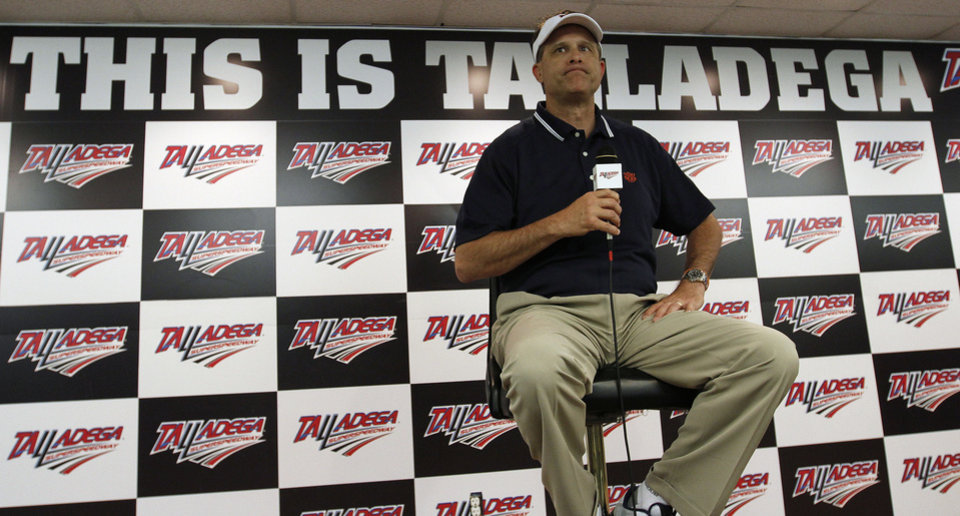 Photo - Auburn Head Football Coach Gus Malzahn speaks during a news conference before the NASCAR Aaron's 499 Sprint Cup series auto race at Talladega Superspeedway, Sunday, May 4, 2014, in Talladega, Ala. (AP Photo/Butch Dill)