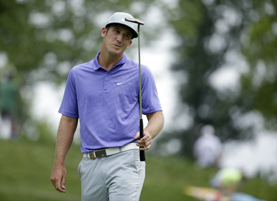 Photo - Kevin Chappell reacts to his putt on the 11th hole during the first round of the PGA Championship golf tournament at Valhalla Golf Club on Thursday, Aug. 7, 2014, in Louisville, Ky. (AP Photo/Jeff Roberson)