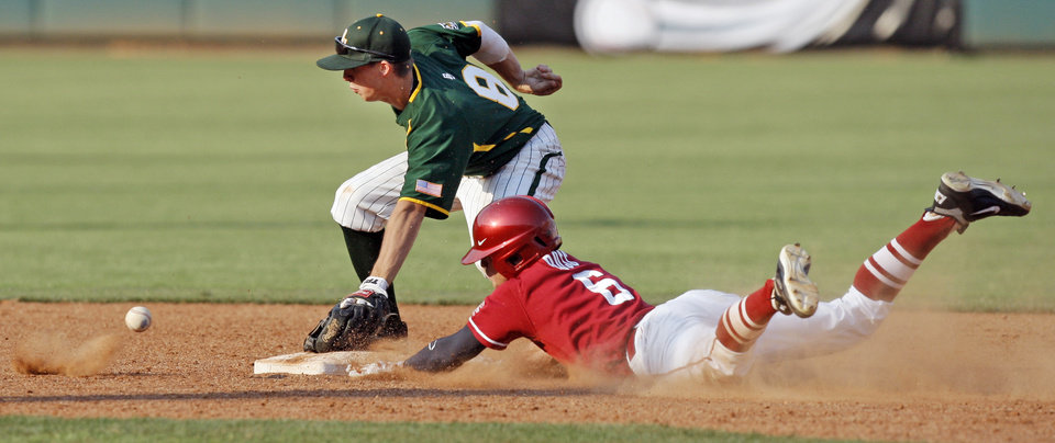 Photo - OU's Erik Ross (6) slides safely to second base as Baylor's Lawton Langford (8) waits for the ball in the ninth inning during a Big 12 Baseball Championship tournament game between the Oklahoma Sooners and Baylor Bears at the Chickasaw Bricktown Ballpark in Oklahoma City,Thursday, May 24, 2012. OU won, 3-2. Photo by Nate Billings, The Oklahoman