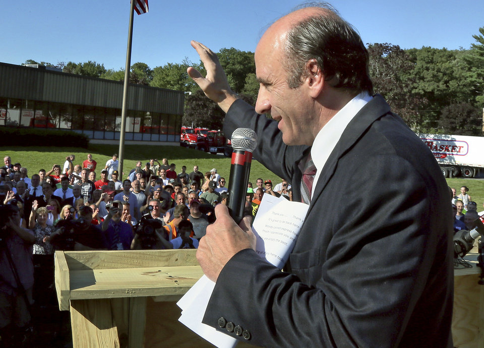 Photo - Restored Market Basket CEO Arthur T. Demoulas speaks to employees at company headquarters, Thursday, Aug. 28, 2014, in Tewksbury, Mass., as he returned to work after reaching an agreement to buy the company. Workers refused to work, and customers stopped shopping at the stores after he was ousted in June. (AP Photo/Boston Herald, Mark Garfinkel) MANDATORY CREDIT. BOSTON GLOBE OUT. METRO BOSTON NEWSPAPER OUT. MAGS OUT.