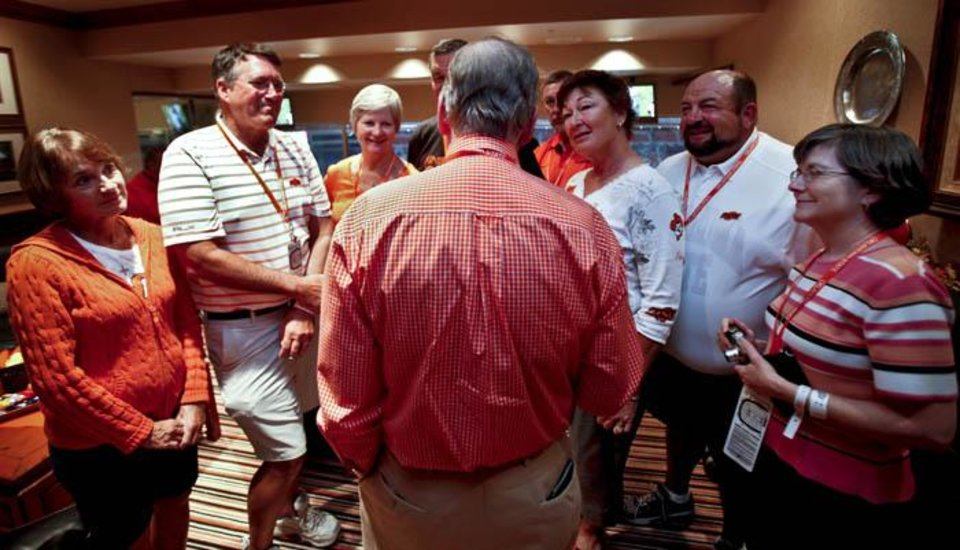 Photo -  OSU / COLLEGE FOOTBALL: Boone Pickens, center, holds court for a group of past and present Holdenville, Okla. residents during game day of the Oklahoma State University Cowboys and the Grambling State University Tigers at Boone Pickens Stadium on Saturday, Sept. 26, 2009, in Stillwater, Okla.  Photo by Chris Landsberger, The Oklahoman. ORG XMIT: KOD