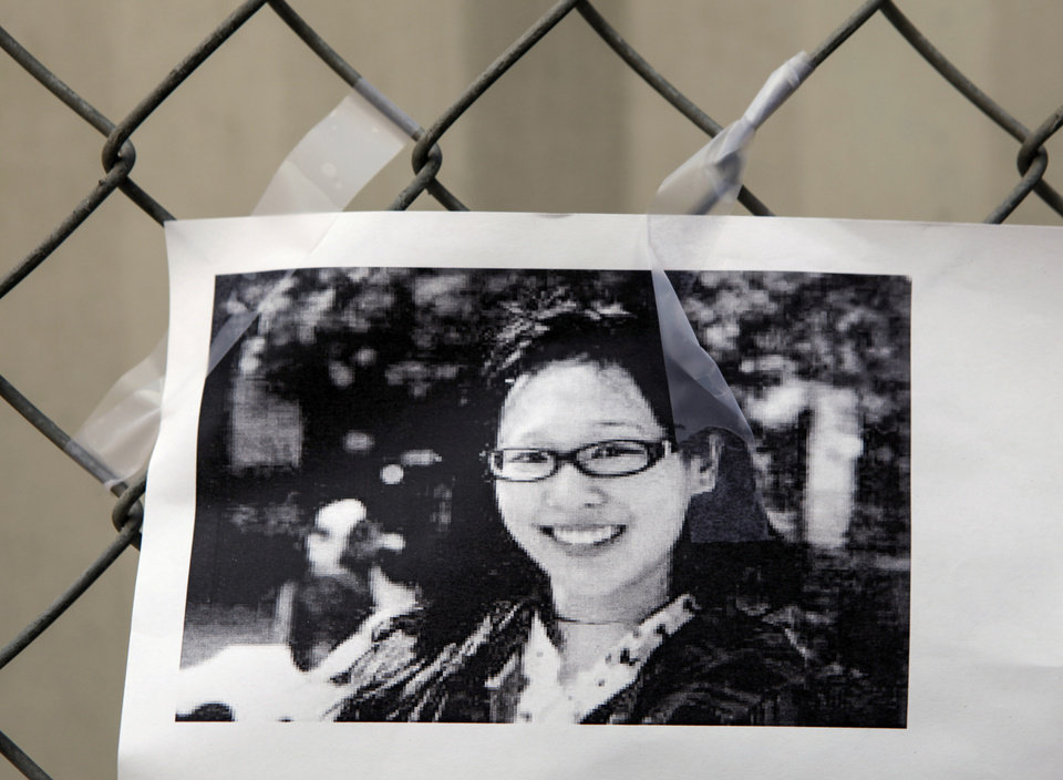 A photocopy showing Elisa Lam  of Canada is displayed at a street memorial across the Cecil Hotel in Los Angeles Thursday, Feb. 21, 2013. Lam, a Canadian tourist, who was last seen last month. Los Angels Police say the body of a woman was found wedged in one of the water tanks on the roof was that of a missing Canadian guest. Investigators used body markings to identify 21-year-old Elisa Lam, police spokeswoman Officer Diana Figueroa said late Tuesday. (AP Photo/Damian Dovarganes)
