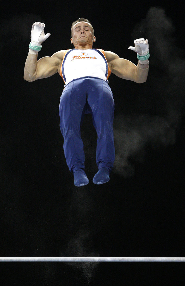 Photo - Illinois' Paul Ruggeri competes on the high bar during the men's NCAA college gymnastics championships in at the Lloyd Noble Center in Norman, Okla., Thursday, April19, 2012. Photo by Bryan Terry, The Oklahoman