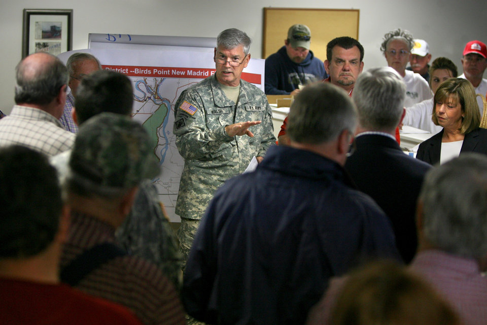 Photo - U.S. Army Corps Engineers Maj. Gen. Michael J. Walsh talks about possible plans to dynamite a Mississippi River levee in Mississippi County, Mo. on Wednesday, April 27, 2011 in East Praire, Mo.  The plan calls for breaching a levee on the Mississippi River at Bird's Point, just below its confluence with the Ohio River at Cairo, Ill., to let floodwater spread across 132,000 acres of sparsely settled bottomland.  Many of the barriers are little more than piles of compacted dirt that were constructed without help from engineers, mainly to protect crops. Now they shield entire communities, and they are managed by local authorities who have little to no money for repairs.  (AP Photo/St. Louis Post-Dispatch, David Carson)