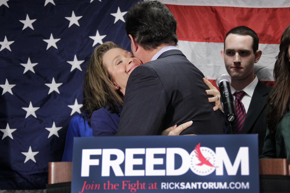 Former Pennsylvania Sen. Rick Santorum gets a hug from his wife Karen after announcing he is suspending his candidacy for the presidency, Tuesday, April 10, 2012, in Gettysburg, Pa. (AP Photo/Gene J. Puskar) ORG XMIT: PAGP107